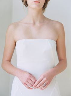 Modern strapless wedding dress: http://www.stylemepretty.com/california-weddings/2016/05/26/edgy-romance-favorite-new-wedding-look/   Photography: Blueberry Photography - http://www.blueberryphotography.com/