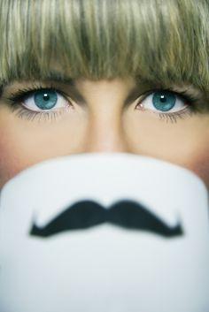Movember portraiture woman funky moustache portraits retouching mug blue eyes beauty