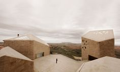 """Location: Roa, Spain;  firm: Estudio Barozzi Veiga;  photos: Mariela Apollonio. description: on the edge of the small Medieval town of Roa in the north of Spain, the new headquarters of the """"Ribera del Duero"""" winery rises up solemnly."""