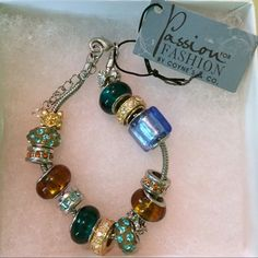 Beaded Bracelet Bracelet with assorted beads, some glass, some have gemstones. Brown and blue shades. Has adjustable clasp. Comes with box. Never worn. Coyne's and Co Jewelry Bracelets