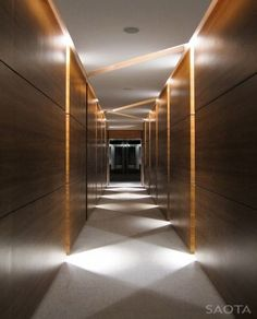This breathtaking architectural masterpiece is immersed onto the edge of a cliff overlooking the Atlantic Ocean. Villa Sow in Dakar, Senegal, western Africa was recently completed by architecture firm SAOTA and ANTONI Associates doing the Hotel Hallway, Hotel Corridor, Long Hallway, Corridor Lighting, Cove Lighting, Interior Lighting, Lighting Ideas, Lighting Design, Corridor Ideas