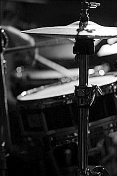 Nice drums portrait, an art gallery style photograph. Notice the overhead lighting and under high hat shadows that make this black and white photograph look like art. - cSw - http://www.pinterest.com/claxtonw/drummer-drumming/ - Nice photo pin via SBandzo.
