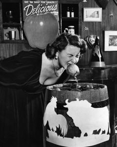 Bobbing for apples on Halloween night, 1949. #vintage #Halloween #1940s