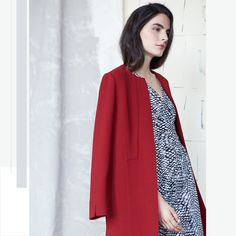 Little red riding hood gets an upgrade – enter the statement zip-front coat.