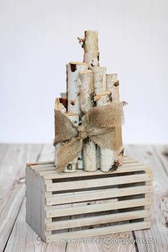 Wrap small birch logs around a glass vase for another centerpiece option?  Rustic Birch Wedding Centerpiece by Essence18 on Etsy, $25.00