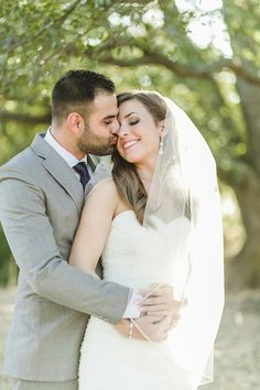 sweet kiss - love the bride's veil too! Anita Martin Photography