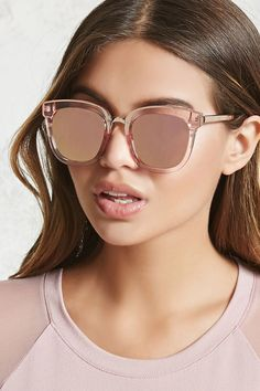 6efb8bad34a A pair of translucent acrylic sunglasses featuring a high-polish bridge and  arms and mirrored