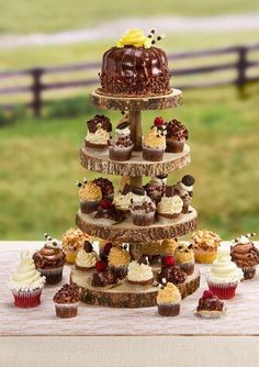 Dont forget about the dessert table! Our rustic wood cupcake stand features 4 wood slice tiers that are perfectly sized for holding bite-size sweets like mini cupcakes. The tiered style makes it great for giving dessert tables a dimensional feel while showcasing treats in style.