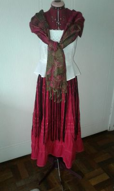 Channeling that inner Frida. ..... Long fringed belt, gypsy skirt, and vintage peplum top