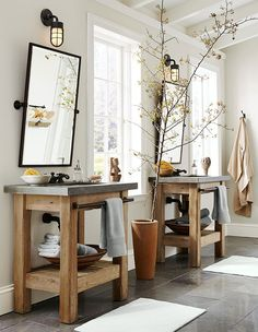 rustic his/her bathroom sinks - love the wood and sink both and the flooring. Townhome bathroom?