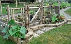 Love the front of this veggie garden and the fencing!