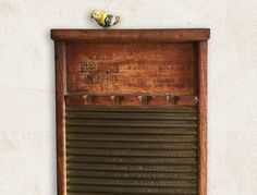 This is a very old washboard from the Brass King National Washboard Company with the top notch soap slots. It has very nice detailing that includes dovetail joints, distressing, and natural aging. This farmhouse, primitive rustic washboard has endless possibilities, and it would make a nice accent in your home or could be hung on the wall. A metal hanger had been added ready for wall display but could be removed.  The washboard is from approximately the 1930s or earlier and is in good…