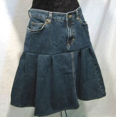 Jean skirt - made from a pair of blue jeans, using the leg portion of material for the bottom ruffle [also a great way to maxi down those mini skirts, adding length] - I like the way it lays, with a little flounce but not too much flare!