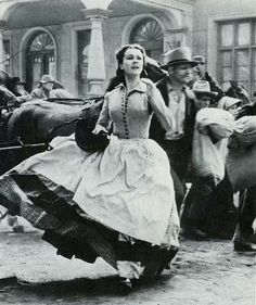 Vivien Leigh as Scarlett O'Hara running in the streets of Atlanta looking for Dr. Meade in 'Gone With The Wind'