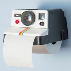 Usually cameras in bathrooms are a no no, unless you're looking to create a retro themed bathroom. For those that love a retro product this Polaroid Camera Toilet Roll Paper Holder will suit you well. Roll Holder, Cool Inventions, Future Inventions, Deco Design, Bath Decor, Tissue Holders, Paper Holders, Modcloth, Retro Vintage
