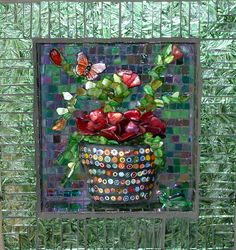 I created a little window garden in this 8' shadow box. Iridescent glass background, metallic tile sides, Van Gogh glass frame, millefiori flower pot, Mother of Pearl plant, button butterfly and glass frog.