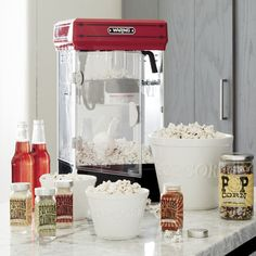 Scaled down for home use with the appeal of a commercial-style popcorn maker, this high-output popper features the classic pivoting kettle and 500 watts of power to pop up to 10 cups of popcorn in just three minutes. Nonstick aluminum kettle with tilt serving access removes for easy cleaning. Large vents for steam release maintain popcorn freshness during storage. Includes a popcorn scoop, oil-measuring spoon and kernel-measuring cup.