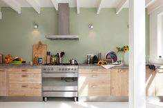 Rotterdam renovation / Photography by Jansje Klazinga, Styling by Holly Marder/Avenue Lifestyle (IKEA cabinets with custom fronts and a concrete countertop).