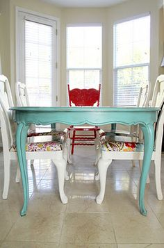 the single red chair at the head of the table perfectly accentuates this dining room ensemble - Colorful Dining Room Tables