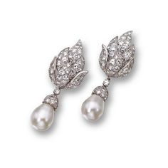 Pair of cultured pearl and diamond pendant-earclips, David Webb. The tops designed as diamond-set clusters of overlapping leaves supporting 2 cultured pearl pendants measuring approximately 12.1 and 11.9 mm., capped by round diamonds, the total diamond weight approximately 12.70 carats, mounted in platinum, pendants detachable. With signed box.