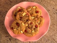 Chocolate chip cookies get holidazzled with white chips, cranberries and almond flavoring.