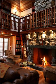 Wonderful fire place and small balcony library. I'm not fond of the overall style of the room, but those two elements are going to be crucial to my home.