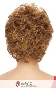 The soft curls and all-over volume of the Hazel, by Estetica Designs, create a vibrant and elegant look that suits many face shapes. The wispy bangs blend into the rest of the lightly curled cut for v