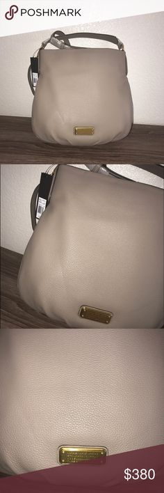 Marc Jacob brand new bag ! In perfect condition it's brand new never used it plastic bags are still on it ! Will not trade OPEN TO OFFERS ! The bag is huge ! You can fit everything in this bag ! Let me know if you guys have any questions ! Does have a short and long strap ! Marc by Marc Jacobs Bags Crossbody Bags
