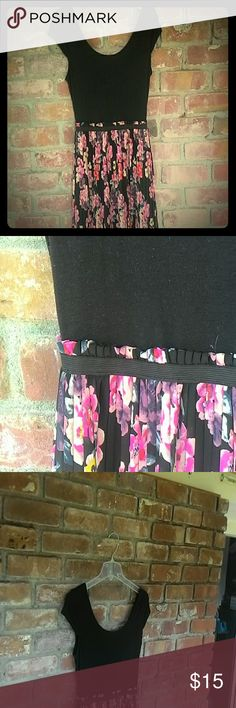 Adorable floral and black hi-lo dress This is super cute and flattering. My favorite treasuries is the slightly low back but you can still wear a normal bra. The pattern is so beautiful, vibrant orange- red, blush and fuchsia floral with gray- green leaves on black pleated sheer over black slip. So fun and playful but black makes it go formal when called upon. Xhilaration Dresses Midi