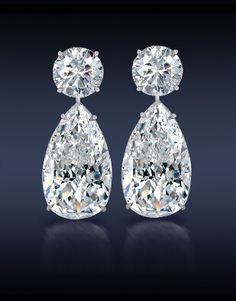 Teardrop Diamond Earrings - Two Perfectly Matched Brilliant Cut Pear Shape Diamonds,  Topped With Two Round Brilliant Cut Diamonds Elegantly Mounted in 18K White Gold.