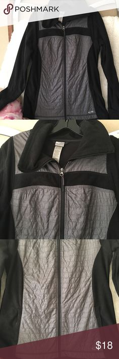 """Champion running exercise yoga jacket NWOT Large Champion black and gray size large zip up jacket never worn. Measures 20"""" armpit to arm pit and 27 1/2"""" shoulder to hem. Two front zipper pockets. Measures 19"""" across at the waist. 100 percent polyester outer piercings, 40 percent and 60 percent polyester inner piercings. Sleeve length from top of shoulder seam to bottom of sleeve hem 27"""". Champion Jackets & Coats Utility Jackets"""