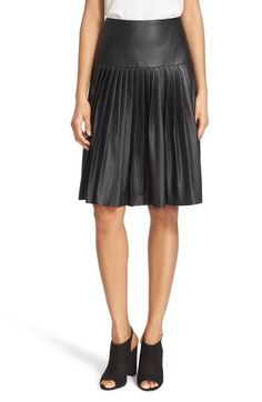 """A wide, smooth yoke creates slimming flattery atop a pleat-flared skirt cut from supple faux leather grained to look like the real thing.      24"""" length (size 8).     Hidden side-zip closure.     Lined.     85% polyester, 15% polyurethane faux leather.     Dry clean.     By Rebecca Taylor; imported."""