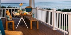 Fiberon Concordia Symmetry composite decking in Warm Sienna installed with white composite railing near the ocean
