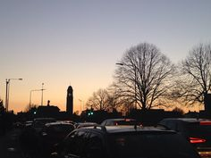 Sunset over churches traffic and trees