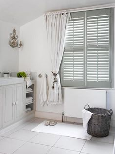 How to mix shutters with curtains | Bathroom shutters. Source…