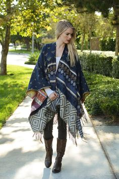 Rio Grande Harvest poncho - Your beach bonfire gear has arrived. It's better than your coziest blanket (no, seriously). The Rio Grande Harvest Poncho features light weight multi-color abstract design, fringe detail, and open front. Wear it with a silky blouse, suede skirt, and tall boots. This poncho is killer with skinnies and ankle boots, or thrown over a maxi dress with layered necklaces.