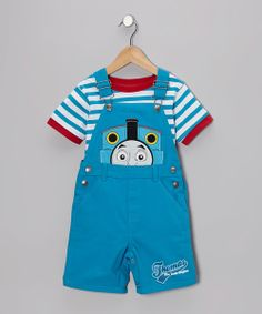 Any little train conductor will be riding the railways of delight when decked out in this darling Thomas outfit. Everyone's favorite talking locomotive decorates the front of these sweet shortalls, and vibrant colors and accents complete the lovable look. Includes tee and shortalls100% cottonMachine wash