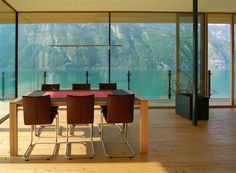 Walensee House by k_m Architektur  (and from within looking out onto still water and rock face...)