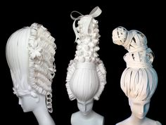 A history-minded way to cover up a bad hair day: Salk and Flurry paper-cut wigs.  I'll take all three.  Wearable Versailles!