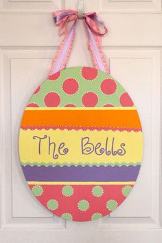 Custom, Personalized Hand Painted Easter Egg Canvas Door Decor. $35.00, via Etsy.