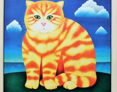 Martin Leman, Vintage Cat Print - Ginger Cat Sitting on Green Island with Blue Sea, Sky & Clouds