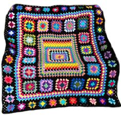 This afghan design was inspired by a magazine from the 1970s. I used 45 different colours to create this one-of-a-kind afghan. Crocheted by me using 100% acrylic yarn, afghan measures approx. 50 in. x 60 in. (127 cm x 153 cm). The afghan has 63 granny squares of 3 different sizes