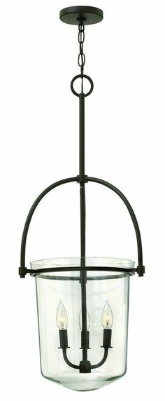 This transitional design features a thick clear glass urn and soft bowed uprights for a masculine yet elegant style. The matching curves of the interior candle cluster add a vintage touch!