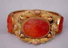 Bracelet, from Pairs 1805/1815  Paris.    Materials and techniques:  etched carnelian; mast gold embossed and chased graineti,  cast (gold), gold masted to the bottom of the bracelet, polished for the set with cameos carnelian; coloring of gold (to decorate green leaves, pink flowers for button), for small yellow leaves around the rosebuds.