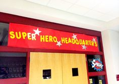 MGES 2014 Staff Appreciation week. Super Hero Theme! Used Red roll paper from copy room & purchased pre-cut letters. For City scape - black construction paper & yellow sticky notes for windows. Office is a fun place to decorate for a lot of impact!
