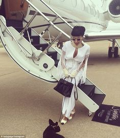 Jet-setting: Gaga, 28, shared another shot outside of her private jet with pup Asia by her feet. She explained to her fans she was off to me...