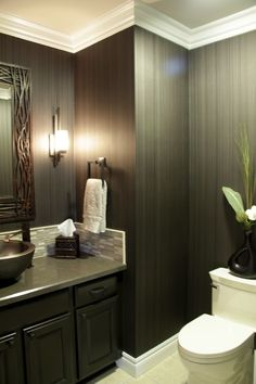This combination of striped wallpaper, white crown molding, and small tile backsplash looks very well coordinated in this powder room Mold In Bathroom, Dark Bathrooms, Diy Bathroom Remodel, Bathroom Ideas, Bathroom Designs, Bathroom Design Inspiration, Design Ideas, Candice Olson, Powder Room Design