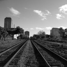 Going into the middle of the city . . . #Orlando #Florida #bnw_captures #bw_society #bnwphotography #monochrome #black #white #thecitybeautiful #traintracks #transportation #leadinglines #Downtown