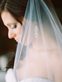 #Brides #Veil - See the wedding on #SMP Weddings: http://www.stylemepretty.com/2013/12/19/omaha-wedding-at-shadowridge-country-club/ Megan Pomeroy Photography