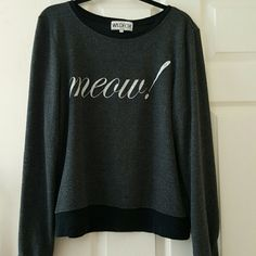 """Meow! Wildfox Baggy Beach Jumper Pulling this all time favorite out to sell and try to recoupe costs of my new wf en route!  Wildfox """"Meow!"""" In dirty black, very broken in, lots of piling, front and back,  except on clean black crew neck trim, sleeves,  and waist.  No pieces in Meow are missing, just normal cracks. No rips, or stains. Just truly loved. Size M Wildfox Sweaters Crew & Scoop Necks"""